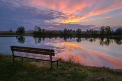 Empty bench at sunset. Empty bench beside the lake at sunset near Zagreb, capital of Croatia Stock Photo