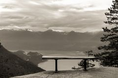 Empty bench on top of a cliff overlooking the Howe Sound. Stock Image