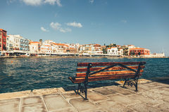 Empty bench with view of the old port in Chania Royalty Free Stock Photography