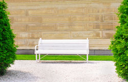 Empty bench on the wall background a sunny day Royalty Free Stock Photo
