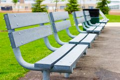 Empty Benches. A row of six empty green plastic benches Stock Images