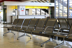 Empty benches at airport waiting area Stock Image