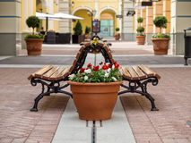 Empty benches and flower pots Royalty Free Stock Photography