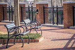Free Empty Benches In A City Park In Spring Royalty Free Stock Image - 90513446