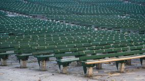 The empty benches of the open air theatre in the fall. royalty free stock images