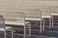 Empty Benches in Rows from Behind, Right Stock Photo