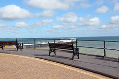 Empty benches beside the sea. Royalty Free Stock Images