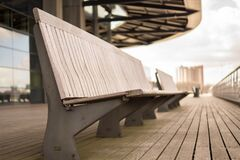Empty benches on walkway Royalty Free Stock Photos