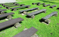 Empty benches. Empty wooden benches in open air royalty free stock images