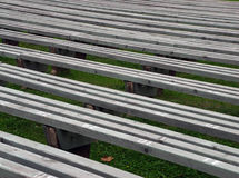 Empty benches. Empty wooden benches in park stock image