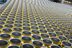 Empty beverage cans on the conveyor belt Stock Photo