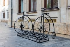Two old time big wheel bicycles rack royalty free stock photos