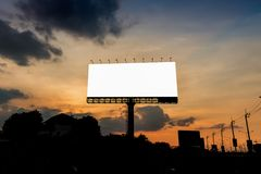 Empty big billboard in sunset. Sky in the city Royalty Free Stock Photography