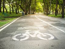 A bike lane for cyclist in the park. An empty  bike lane for cyclist in the park Royalty Free Stock Photo