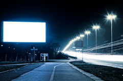 Empty bilboard. Bilboard at the night. Selective focus on the blank bilboard stock images