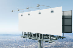 Empty bill board on city background side. Side view of empty bill board on city background. Advertisement concept. 3D Rendering Stock Photography