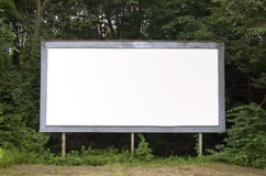 Empty Billboard. A blank billboard find in a suburban area with plenty of copy space. Includes the clipping path royalty free stock photography