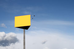 Empty Billboard. An empty billboard with a large yellow area against a blue sky Stock Images