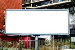 Empty billboard against urban background Stock Photos