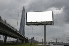 Empty Billboard on the background of a large modern office building, ordinary business skyscrapers, high-rise buildings, architect royalty free stock images