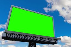 Empty billboard with chroma key green screen, on blue sky with c stock image