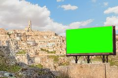 Empty billboard with chroma key green screen, panoramic view of royalty free stock photography