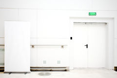 Empty billboard and doors Royalty Free Stock Photos