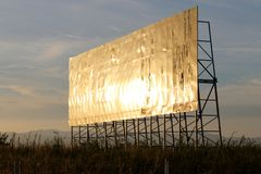 Empty billboard in the evening. Billboard shining with the evening sunlight. Useful for talking about publicity or advertisements in general, without showing a royalty free stock image