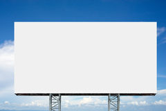 Empty billboard in front of cloudy sky Stock Photos