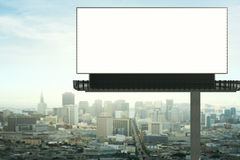 Empty billboard front. Front view of empty billboard on city background. Retail concept. Mock up, 3D Rendering Royalty Free Stock Image