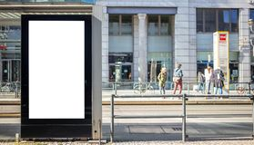 Empty billboard for public advertisement at the bus stop. Space for text. People and city background. Blank billboard for public advertisement at the bus stop royalty free stock photography