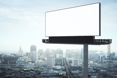 Empty billboard side. Side view of empty billboard on city background. Retail concept. Mock up, 3D Rendering Stock Photo