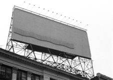 Empty billboard on top of building with lights panel stock photos