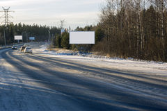 Empty billboards along the road. Empty billboards along the winter city road Royalty Free Stock Photography