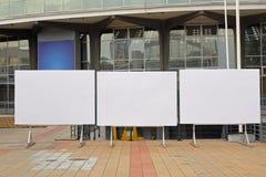 Empty billboards. Three empty billboards in front of fair building Stock Image