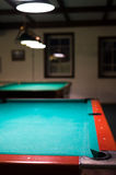 Empty billiard table under the lights Royalty Free Stock Photography