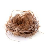 Empty bird nest isolated over a white background. Empty bird nest isolated on a white background, absence, animal, animals, architecture, blank, brown, buildings royalty free stock image