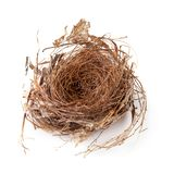 Empty bird nest isolated over a white background. Empty bird nest isolated on a white background, absence, animal, animals, architecture, blank, brown, buildings royalty free stock images