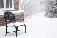 Empty Black Bench in Snow Stock Images