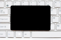Empty black blank card on computer keyboard Royalty Free Stock Image