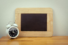 Empty black board and clock Stock Photo