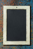 Empty black board on a dark background, top view, vertical Royalty Free Stock Image