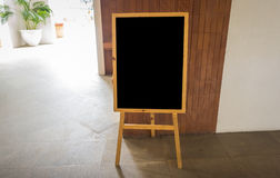 Empty black board  at  restaurant . Stock Photos