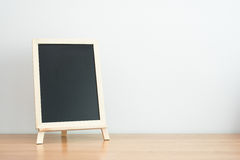 Empty black board on table Royalty Free Stock Photos