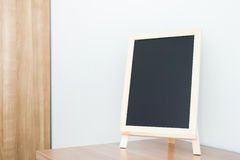 Empty black board on table Royalty Free Stock Photo