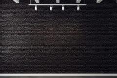 Empty brick wall. Empty black brick wall illuminated with lamps. Mock up, 3D Rendering Stock Image