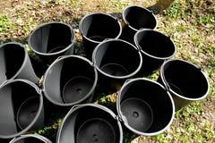 Empty black buckets Stock Image