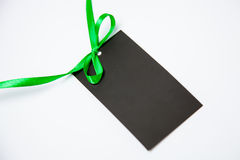 Empty black card with bow. On white background Stock Photos