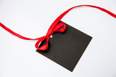 Empty black card with bow. On white background Stock Images