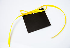 Empty black card with bow. On white background Royalty Free Stock Images